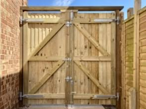 94 Pair of close board gates