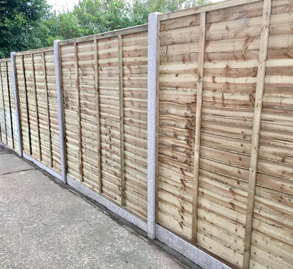 60 Waney edge panels with slotted concrete posts