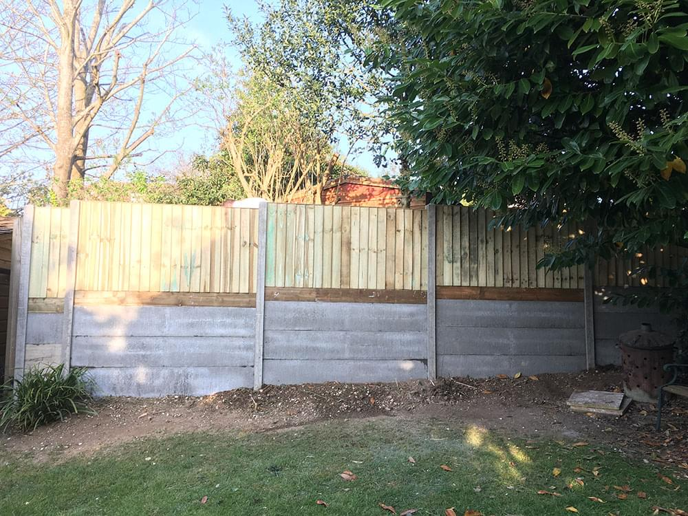 41 Concrete gravel boards retaining the higher level
